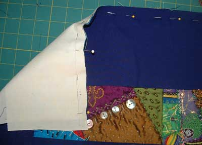 pin border to front and lining to back