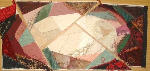 The crazy quilt pieces to make box top