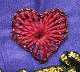 ...Surrounded by buttonhole stitch