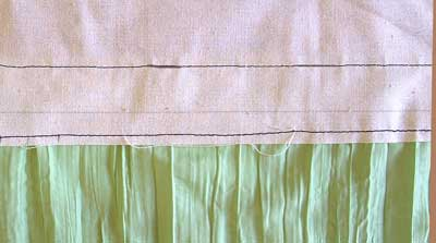 turn over and stitch near edge of lining
