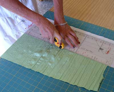 cut border fabric level with edge of lining