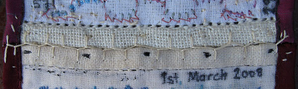 Back view of join between the second and third panels of sampler