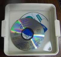 soak CD in warm water to soften